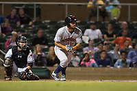 Scottsdale Scorpions third baseman Abraham Toro (28), of the Houston Astros organization, starts down the first base line in front of catcher Daulton Varsho (8) during an Arizona Fall League game against the Salt River Rafters at Salt River Fields at Talking Stick on October 11, 2018 in Scottsdale, Arizona. Salt River defeated Scottsdale 7-6. (Zachary Lucy/Four Seam Images)