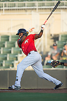 Micker Aldofo (37) of the Kannapolis Intimidators follows through on his swing against the Lakewood BlueClaws at Kannapolis Intimidators Stadium on August 11, 2016 in Kannapolis, North Carolina.  The Intimidators defeated the BlueClaws 3-1.  (Brian Westerholt/Four Seam Images)