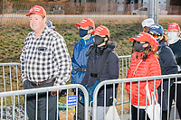 People wait in line to enter a Make America Great Again Victory Rally with US President Donald Trump in the final week before the Nov. 3 election at Pro Star Aviation in Londonderry, New Hampshire, on Sun., Oct. 25, 2020. Many wore MAGA hats and other Donald Trump paraphernalia.