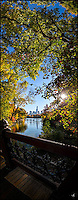 A view from Oak Bridge in Central Park in a fall afternoon, of the Lake and Central Park South skyline.