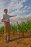 Laurent Cogombles owner and winemaker together with his wife Sophie Lurton in the vineyard, showing how high the canopy (leaves and branches) will finally be  Chateau Bouscaut Cru Classe Cadaujac  Graves Pessac Leognan  Bordeaux Gironde Aquitaine France