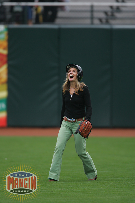 SAN FRANCISCO, CA - SEPTEMBER 14: Photographer Deanne Fitzmaurice participates in a fly ball catching contest in right field before the game between the San Diego Padres and San Francisco Giants at AT&T Park on September 14, 2005 in San Francisco, California. Photo by Brad Mangin