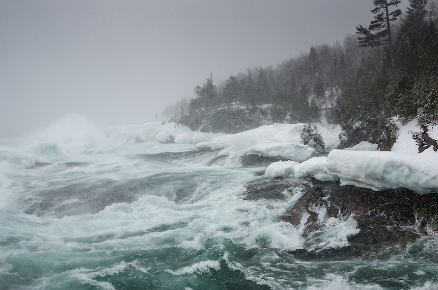 Large Lake Superior waves from blizzard-like conditions during a spring winter storm. Marquette, MI