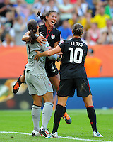 Hope Solo, Shannon Boxx and Carli Lloyd celebrate during the FIFA Women's World Cup at the FIFA Stadium in Dresden, Germany on July 10th, 2011.