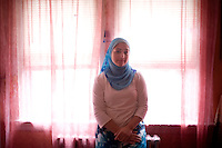 """Shayreen, 16, poses for a portrait in her beedroom in her home in West Warwick, Rhode Island, USA, on Sunday, Aug. 22, 2011.  Unlike the rest of her family, Shayreen is very devoted to her Muslim faith.  """"I feel it's my responsibility as a Muslim to be a positive role model,"""" said Shayreen, """"I see a negative energy toward Muslims in the media.""""  Shayreen is will be a high school junior at Lincoln School, an all-girls Quaker school in Rhode Island. The rest of her family is not particularly religious.  When Shayreen began wearing the hijab head covering in her early teens, """"My parents were very supportive, but my aunt tried to talk me out of it. My grandmother was upset.  I was more worried about what my family would think [than what other people would think].""""..photo by: M. Scott Brauer for Education Week"""