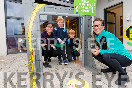 Harry and Joey O'Connor with their mum Alice Hayes welcomed by Mol an Óige childcare Gemma Durrant at the reopening of Mol an Óige, Dingle, on Monday morning.