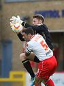Mark Gillespie of Carlisle gathers under pressure from Jon Ashton of Stevenage<br />  - Stevenage v Carlisle Untied - Sky Bet League 1 - Lamex Stadium, Stevenage - 21st September, 2013<br />  © Kevin Coleman 2013