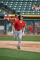 Auston Bousfield (32) of the El Paso Chihuahuas runs to first base against the Salt Lake Bees at Smith's Ballpark on July 8, 2018 in Salt Lake City, Utah. El Paso defeated Salt Lake 15-6. (Stephen Smith/Four Seam Images)