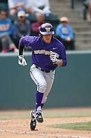 Braden Bishop #7 of the Washington Huskies runs to first base during a baseball game against the UCLA Bruins at Jackie Robinson Stadium on March 17, 2013 in Los Angeles, California. (Larry Goren/Four Seam Images)