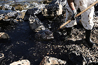 """Pictured: Specialist crew clean up the oil spill that has reached the coast of Salamina, Greece<br /> Re: An oil spill off Salamina island's eastern coast is spreading and has become """"an environmental disaster"""" according to local authorities in Greece.<br /> The spill was caused by the sinking of the Aghia Zoni II tanker, carrying 2,200 metric tons of fuel oil and 370 metric tons of marine gas oil on Saturday, southwest of the islet of Atalanti near Psytalleia. According to reports, the coastline stretching from Kinosoura to the Selinia community has """"turned black"""" and authorities fear a new leak from the sunken ship.<br /> According to the island's mayor, Isidora Papathanasiou, the weather """"turned on Sunday afternoon and brought the oil spill to Salamina."""""""