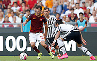 Calcio, Serie A: Roma vs Juventus. Roma, stadio Olimpico, 30 agosto 2015.<br /> Roma's Miralem Pjanic, left, is challenged by Juventus' Stefano Sturaro, center, and Martin Caceres during the Italian Serie A football match between Roma and Juventus at Rome's Olympic stadium, 30 August 2015.<br /> UPDATE IMAGES PRESS/Riccardo De Luca