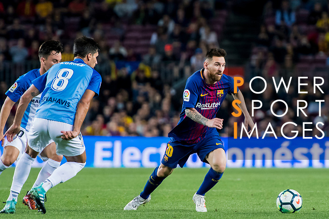 Lionel Andres Messi (r) of FC Barcelona fights for the ball with Juan Pablo Anor Acosta, Juanpi (l) and Adrian Gonzalez Morales of Malaga CF during the La Liga 2017-18 match between FC Barcelona and Malaga CF at Camp Nou on 21 October 2017 in Barcelona, Spain. Photo by Vicens Gimenez / Power Sport Images