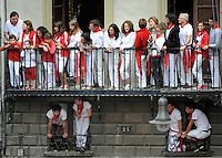 San Fermin, July. Pamplona : People celebrate while brandishing the traditional red bandana, on July 6 every year during the Chupinazo, the beginning of the San Fermin Fair where more than a million people are expected, including those who will take their chances in the bull run. Participants run with fighting bulls during a  San Fermin bull run in Pamplona. On each day of the San Fermin festival six bulls are released at 8:00 a.m. (0600 GMT) to run from their corral through the narrow, cobbled streets of the old navarre town over an 850-meter (yard) course. Ahead of them are the runners, who try to stay close to the bulls without falling over or being gored. Photo: Ander Gillenea.