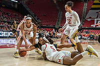 COLLEGE PARK, MD - FEBRUARY 13: Stephanie Jones #24 of Maryland and Kaila Charles #5 of Maryland vie for the ball with Alexis Sevillian #5 of Iowa during a game between Iowa and Maryland at Xfinity Center on February 13, 2020 in College Park, Maryland.