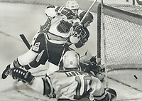 1987 FILE PHOTO - ARCHIVES -<br /> <br /> Let's dance: NHL all-star Kevin Dineen and Soviet defenceman Vyacheslav Fetisov watch Dineen's shot trickle into the net during action at Quebec Colisee last night. The two players continued into the net but neither was injured. The NHL stars held on to defeat the Soviets 4-3 on Dave Poulin's goal.<br /> <br /> PHOTO :  Mike Slaughter  - Toronto Star Archives - AQP