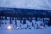 Mushers & teams rest in the early evening @ Rainy Pass Chkpt 2006 Iditarod Rainy Pass Alaska Winter