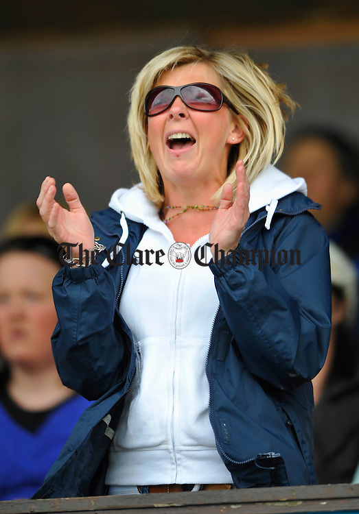 Anxious mother of Ryan Fleming, the Dal gCais goalie,  Rose Fleming cheers on her team during their U-12 Division 3 championship final in Cusack Park. Photograph by John Kelly.