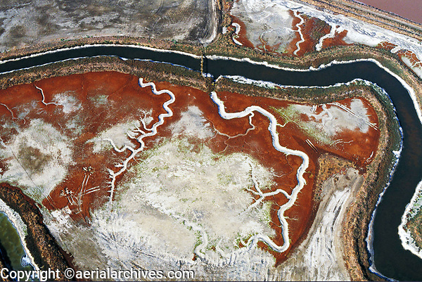 aerial photograph of a salt crystallizer pond following ancient tidal channels. San Francisco bay. California