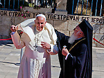 Ecumenical Patriarch Bartholomew helps Pope Francis with his cape as they meet at  Viri Galilaei on the mount of Olives in Jerusalem Monday May 26 2014.The meeting was part of Pope Francis three day visit to the region. Photo by Eyal Warshavsky