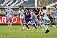 KANSAS CITY, KS - SEPTEMBER 23: Rodrigo Schlegel #15 of Orlando City brings the ball out of his penalty area during a game between Orlando City SC and Sporting Kansas City at Children's Mercy Park on September 23, 2020 in Kansas City, Kansas.