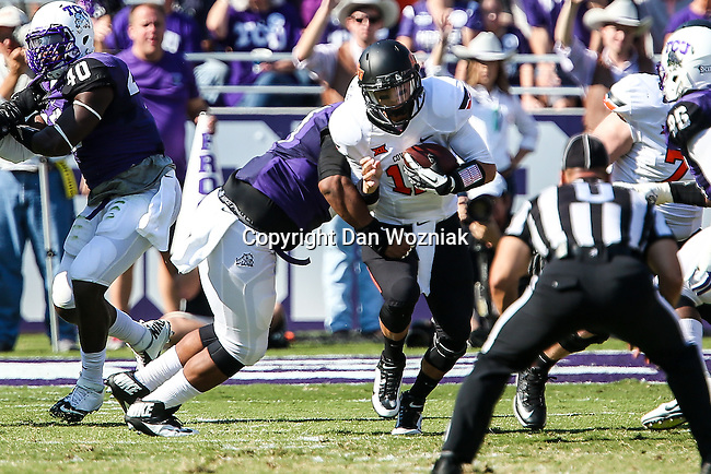 Oklahoma State Cowboys quarterback Daxx Garman (12) and TCU Horned Frogs defensive tackle Davion Pierson (57) in action during the game between the OSU Cowboys and the TCU Horned Frogs at the Amon G. Carter Stadium in Fort Worth, Texas. TCU defeated OSU 42 to 9.