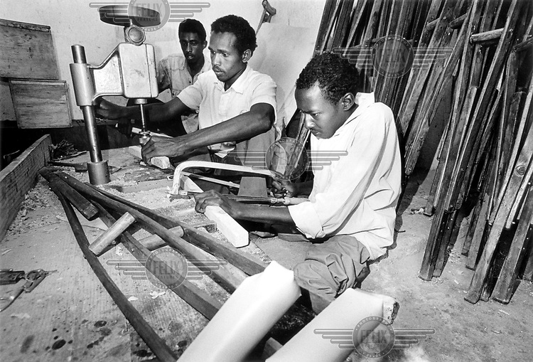 © Hamish Wilson / Panos Pictures..SOMALILAND..Disability co-operative making crutches for sale to Handicap International.
