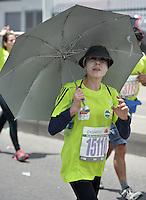 BOGOTÁ -COLOMBIA. 27-07-2014. Aspecto de los participantes en la Media Maratón de Bogotá 2014. En esta ocasión Geoffrey Kipsang (Kenia) fue el ganador con un tiempo de 1.03:18 y en mujeres Rita Jeptoo (Kenia)con un tiempo de 1.13:36. / Aspect of the people during the Half Marathon of Bogota 2014. In this edition the winner was Geoffrey Kipsang (Kenya) with a time of 1.03:18 and in women the winner  was Rita Jeptoo (Kenya) with a time of 1.13:36. Photo: VizzorImage/ Gabriel Aponte / Staff