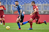 Marcelo Brozovic of FC Internazionale and Henrikh Mkhitaryan of AS Roma compete for the ball during the Serie A football match between AS Roma and FC Internazionale at Olimpico stadium in Roma (Italy), January 10th, 2021. Photo Andrea Staccioli / Insidefoto