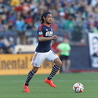 New England Revolution midfielder Daigo Kobayashi (16) dribbles at midfield.  In a Major League Soccer (MLS) match, the New England Revolution (blue/white) defeated Houston Dynamo (orange), 2-0, at Gillette Stadium on April 12, 2014.