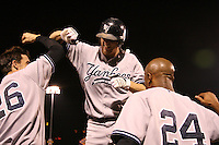 September 4, 2009:  Outfielder Shelley Duncan of the Scranton Wilkes-Barre Yankees celebrates with Christ Stewart and Austin Jackson after scoring the winning run during a game at Frontier Field in Rochester, NY.  Scranton is the Triple-A International League affiliate of the New York Yankees and clinched the North Division Title with a victory over Rochester.  Photo By Mike Janes/Four Seam Images