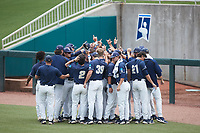 The Wingate Bulldogs huddle up prior to the game against the Central Missouri Mules at the 2021 DII Baseball National Championship at Coleman Field at the USA Baseball National Training Complex on June 12, 2021 in Cary, North Carolina. The Bulldogs defeated the Mules 5-3. (Brian Westerholt/Four Seam Images)