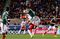 Harrison, NJ - Tuesday April 10, 2018: Carlos Salcido, Derrick Etienne Jr. during leg two of a  CONCACAF Champions League semi-final match between the New York Red Bulls and C. D. Guadalajara at Red Bull Arena. C. D. Guadalajara defeated the New York Red Bulls 0-0 (1-0 on aggregate).