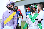 March 27 2021: Jockeys entering the paddock for the Al Quoz Sprint at Meydan Racecourse, Dubai, UAE. Shamela Hanley/Eclipse Sportswire/CSM