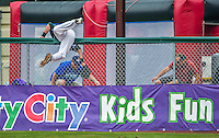 9 July 2015: Vermont Lake Monsters outfielder Seth Brown tries to get to a home-run ball as it clears the fence during game action against the Mahoning Valley Scrappers at Centennial Field in Burlington, Vermont. The Lake Monsters rallied to tie the game 4-4 in the bottom of the 9th, but fell to the Scrappers 8-4 in 12 innings of NY Penn League play. Mandatory Credit: Ed Wolfstein Photo *** RAW Image File Available ****