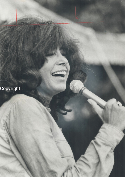 1971 FILE PHOTO - ARCHIVES -<br /> <br /> Singer Pauline Julien was one of the headline performers at the Mariposa Folk Festival. Quebec's foremost chanteuse captivated her audience during her performance and no one minded they couldn't understand French lyrics<br /> <br /> PHOTO : Ron BULL - Toronto Star Archives - AQP