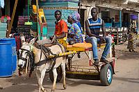 Senegal, Touba.  Horse-drawn Carts Provide Taxi Service for Market Shoppers.