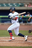 Andres Melendez (20) of the Lynchburg Hillcats follows through on his swing against the Myrtle Beach Pelicans at Bank of the James Stadium on May 23, 2021 in Lynchburg, Virginia. (Brian Westerholt/Four Seam Images)