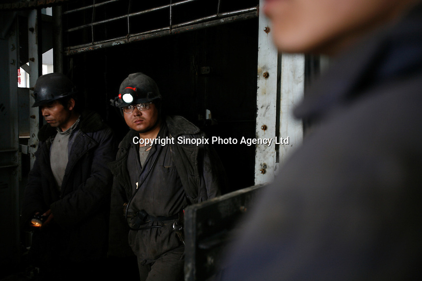 Coal miners exiting a lift after a 12-hour shift at one of the state-owned mines near Luoyang, Henan Province, China..