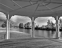 Looking south through gazebo in park on Willamette River. Harrisburg, Oregon