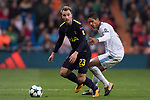Christian Eriksen of Tottenham Hotspur FC (L) fights for the ball with Raphael Varane of Real Madrid (R) during the UEFA Champions League 2017-18 match between Real Madrid and Tottenham Hotspur FC at Estadio Santiago Bernabeu on 17 October 2017 in Madrid, Spain. Photo by Diego Gonzalez / Power Sport Images
