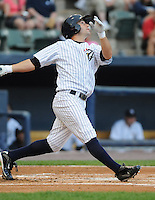 Outfielder Austin Krum (13) of the Scranton/Wilkes-Barre Yankees, International League affiliate of the New York Yankees, in a game against the Norfolk Tides on June 20, 2011, at PNC Park in Moosic, Pennsylvania. (Tom Priddy/Four Seam Images)