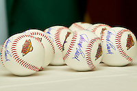 All-Star game baseballs are autographed by Cincinnati Reds Hall of Fame catcher Johnny Bench at the California League - Carolina League All-Star Game Luncheon at the Embassy Suites hotel on June 19, 2012 in Winston-Salem, North Carolina.  (Brian Westerholt/Four Seam Images)