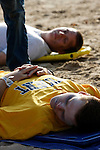 Two mass casualty incident victims on backboards on a beach waiting transport