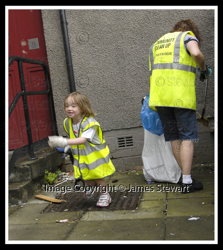"""25/07/2007       Copyright Pic: James Stewart.File Name : jspa03_denny.DENNY RESIDENTS """"BOLD"""" LITTER COLLECTING GROUP......James Stewart Photo Agency 19 Carronlea Drive, Falkirk. FK2 8DN      Vat Reg No. 607 6932 25.Office     : +44 (0)1324 570906     .Mobile   : +44 (0)7721 416997.Fax         : +44 (0)1324 570906.E-mail  :  jim@jspa.co.uk.If you require further information then contact Jim Stewart on any of the numbers above........."""