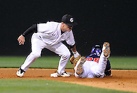 Shortstop Peter Mooney (6) of the South Carolina Gamecocks tags out Chris Epps (26) of the Clemson Tigers attempting a steal on Tuesday, March 8, 2011, at Fluor Field in Greenville, S.C. South Carolina won 5-4. Photo by Tom Priddy / Four Seam Images.