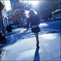 Schoolgirl walking down street<br />