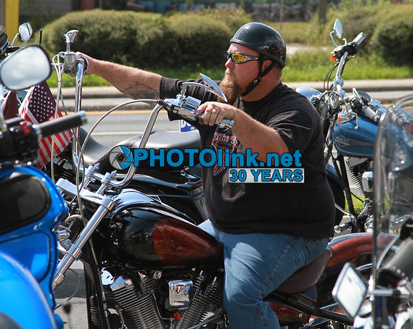 Docs3924.JPG<br /> 3/30/2013<br /> Dade CIty, FL 9/23/12<br /> Doc's Grille Motorcycle Fest<br /> Photo by Adam Scull/PHOTOlink.net<br /> 917-754-8588 - eMail: adam@photolink.net
