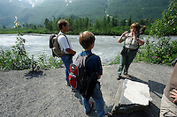 U.S. Forest Service guide Saralynn Fenwick explains some geology to James Clark, far left, and his son Anton. The Alaska Railroad's Spencer Glacier Whistlestop train gives visitors access to hiking, camping and stunning views.