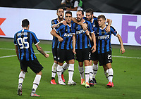 21st August 2020, Rheinenergiestadion, Cologne, Germany; Europa League Cup final Sevilla versus Inter Milan;  Diego Godin of Inter Milan celebrates with teammates after scoring his team's second goal for 2-2