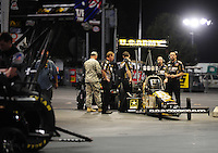 Jun. 15, 2012; Bristol, TN, USA: NHRA crew members for top fuel dragster driver Tony Schumacher during qualifying for the Thunder Valley Nationals at Bristol Dragway. Mandatory Credit: Mark J. Rebilas-